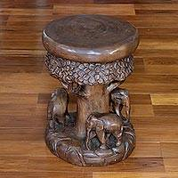 Wood stool, 'Around the Tree in Brown' - Wood Stool of Elephants Around a Tree in Brown from Thailand