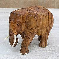 Teakwood sculpture, 'Go For a Walk' (left) - Teakwood Sculpture of a Left-Facing Elephant from Thailand