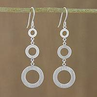 Sterling silver dangle earrings, 'Cool Rings' - Circle Motif Sterling Silver Dangle Earrings from Thailand