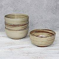 Ceramic cereal bowls, 'Typhoon' (set of 4) - Handcrafted Beige and Brown Set of Four Ceramic Cereal Bowls