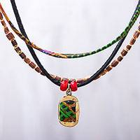 Cotton and wood beaded pendant necklace, 'Festive Mix' - Triple Strand Colorful Wood Cotton Brass Pendant Necklace