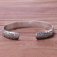 Silver cuff bracelet, 'Seaside Trail' - Handcrafted Karen Silver Fish and Flower Motif Cuff Bracelet