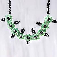 Quartz beaded pendant necklace, 'Green Plum Blossoms' - Green and Black Quartz Floral Beaded Pendant Necklace