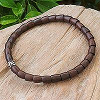 Wood and sterling silver beaded necklace, 'Dark Spiral Bangle' - Dark Wood and Sterling Silver Beaded Stretch Necklace