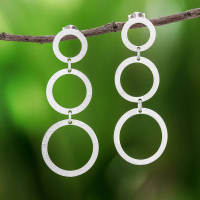 Sterling silver dangle earrings, 'Moon Triplets' - Circle Pattern Sterling Silver Dangle Earrings from Thailand