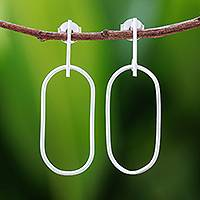 Sterling silver dangle earrings, 'Fascinating Rings' - Oval-Shaped Sterling Silver Dangle Earrings from Thailand