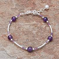 Amethyst beaded bracelet, 'Violet Sound' - Amethyst Beaded Bracelet with a Bell Charm from Thailan
