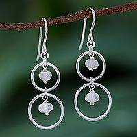 Rose quartz dangle earrings, 'Rosy Orbits' - Natural Rose Quartz Dangle Earrings with Sterling Rings