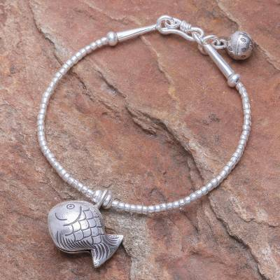 Silver beaded charm bracelet, 'Singing Hill Tribe Goldfish' - Karen Hill Tribe Silver Goldfish Bracelet with Ringing Bells