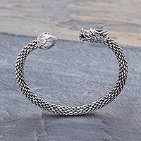 Sterling silver cuff bracelet, 'Dragon and Lotus' - Unisex Sterling Silver Cuff with Dragon and Lotus