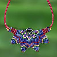 Onyx macrame pendant necklace, 'Bohemian Star' - Red and Blue Macrame Necklace with Onyx