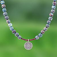 Jasper and garnet pendant necklace, 'Spiral Earth' - Jasper and Garnet Beaded Necklace with 950 Silver Pendant