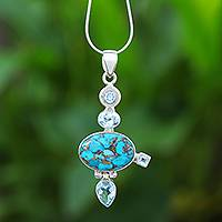 Blue topaz pendant necklace, 'Blue Orbit' - Blue Topaz and reconstituted Turquoise Pendant Necklace
