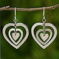 Sterling silver heart earrings, 'Hypnotic Love' - Sterling silver heart earrings