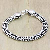 Sterling silver braided bracelet, 'Herringbone' - Handcrafted Sterling Silver Bracelet from Bali and Java