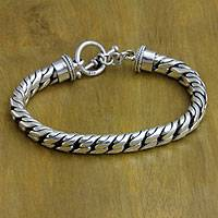 Sterling silver braided bracelet, 'Strength and Valor'