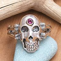 Men's garnet ring, 'Pirate's Jewel' - Men's Handcrafted Silver Skull RIng