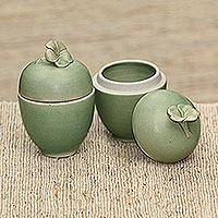 Ceramic condiment jars, 'Frangipani Surprise' (pair) - Bali Artisan Handcrafted Green Floral 2 Condiment Jars
