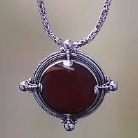 Carnelian pendant necklace, 'Power' - Handcrafted Carnelian and Sterling Silver Pendant