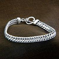 Sterling silver braided bracelet, 'Links of Power' - Sterling Silver Chain Bracelet