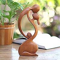 Wood sculpture, 'A Mother's Kiss' - Elegant Curved Mother and Child Sculpture