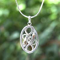 Sterling silver pendant necklace, 'Intertwined' - Sterling silver pendant necklace