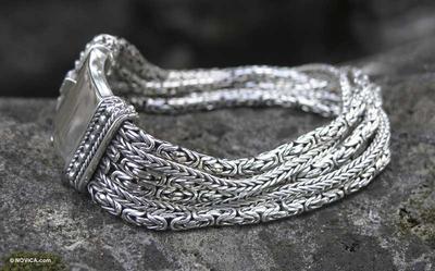 Sterling silver braided bracelet, 'Embrace Unity' - Sterling Silver Wristband Bracelet
