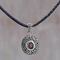 Leather and garnet pendant necklace, 'Wild Beauty' - Unique Garnet and Silver Pendant Necklace