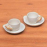 Ceramic teacups and saucers, 'White Beach' (pair) - Handmade Ceramic Teacups and Saucers (Pair)