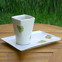 Stoneware ceramic cup and saucer, 'The Falling Leaf' - Stoneware Ceramic Cup and Saucer