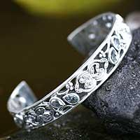 Blue topaz cuff bracelet, 'Blue Dewdrops' - Blue Topaz Floral Sterling Silver Cuff Bracelet