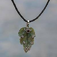 Agate and garnet pendant necklace, 'Lush Leaf' - Leather Necklace with Carved Moss Agate Pendant