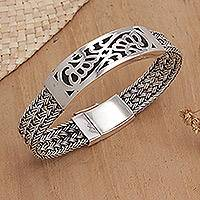 Sterling silver bangle bracelet, 'Crown of Petals' - Floral Sterling Silver Wristband Bracelet