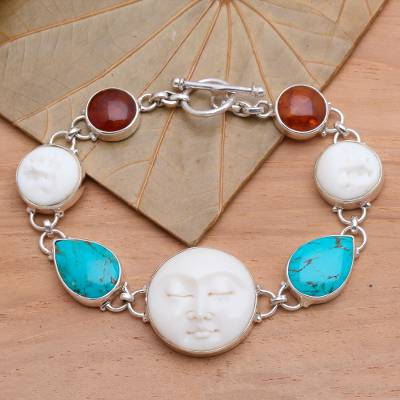Amber and carved bone bracelet, Goddesses