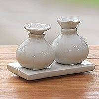 Ceramic oil bottles, 'White Bali Frangipani' (pair) - Floral Ceramic Oil Bottles (Pair)