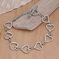 Sterling Silver heart bracelet, 'Story of Love' - Silver Bracelet Featuring Stamped Hearts