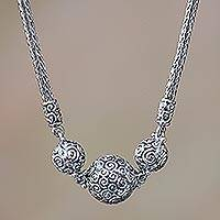 Sterling silver pendant necklace, 'Ringlets' - Sterling silver pendant necklace