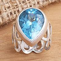 Blue topaz solitaire ring, 'Enchanted Bali' - Modern Sterling Silver and Blue Topaz Ring