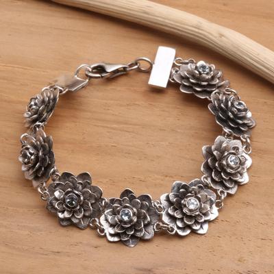 Blue topaz flower bracelet, 'Sacred Blue Lotus' - Hand Crafted Floral Sterling Silver and Blue Topaz Bracelet