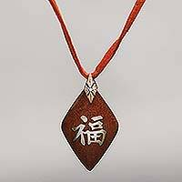 Wood pendant necklace, 'Good Fortune' - Wood pendant necklace
