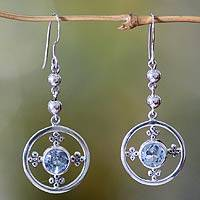 Blue topaz dangle earrings, 'Around the World' - Handcrafted Sterling Silver and Blue Topaz Dangle Earrings
