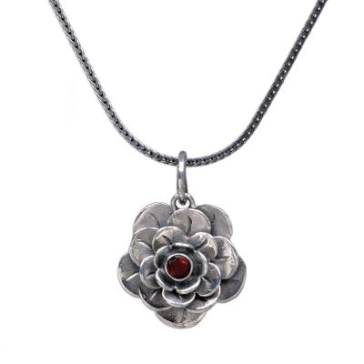 Garnet flower necklace, 'Holy Lotus' - Floral Sterling Silver and Garnet Pendant Necklace