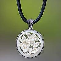 Leather and cow bone flower necklace, 'Wild Hibiscus' - Hand Crafted Floral Cow Bone Pendant Necklace