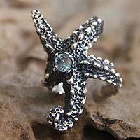 Blue topaz wrap ring, 'Balinese Starfish' - Animal-Themed Sterling Silver and Blue Topaz Ring