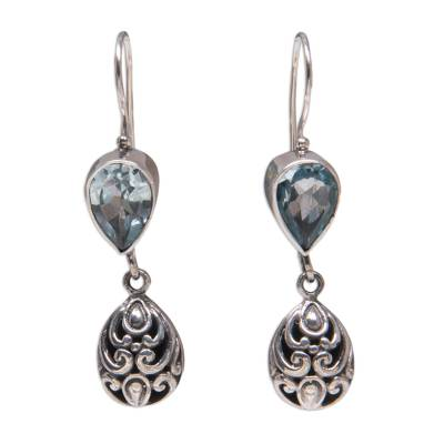 Blue topaz dangle earrings, 'Lotus Bud' - Hand Crafted Sterling Silver and Blue Topaz Earrings