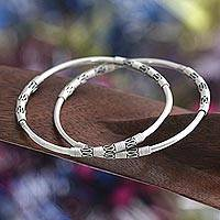 Sterling silver bangle bracelets, 'Secrets' (pair) - Unique Sterling Silver Women's Bangle Bracelet