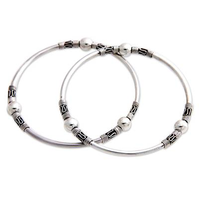 Sterling silver bangle bracelets, 'Ubud Moons' (pair) - Sterling Silver Bangle Bracelets from Indonesia (Pair)