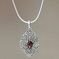 Garnet pendant necklace, 'Balinese Romance' - Sterling Silver and Garnet Pendant Necklace