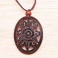 Coconut shell floral necklace, 'Blossoming Hibiscus' - Floral Coconut Shell Pendant Necklace from Indonesia