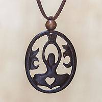 Coconut shell pendant necklace, 'Sukhasana Yoga'